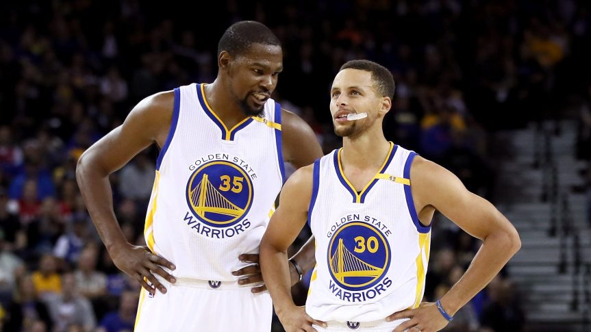 OAKLAND, CA - OCTOBER 04:  Kevin Durant #35 talks to Stephen Curry #30 of the Golden State Warriors during their game against the Los Angeles Clippers during their preseason game at ORACLE Arena on October 4, 2016 in Oakland, California.  NOTE TO USER: User expressly acknowledges and agrees that, by downloading and or using this photograph, User is consenting to the terms and conditions of the Getty Images License Agreement.  (Photo by Ezra Shaw/Getty Images)